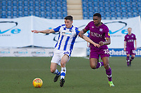 Diaz Wright of Colchester United and Kelvin Etuhu of Carlisle United compete for the ball during Colchester United vs Carlisle United, Sky Bet EFL League 2 Football at the JobServe Community Stadium on 23rd February 2019