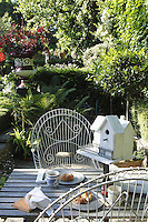 Breakfast is enjoyed on the garden table in the early morning sunlight which bathes the patio