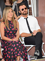 Jennifer Aniston &amp; Justin Theroux at the Hollywood Walk of Fame Star Ceremony honoring actor Jason Bateman. Los Angeles, USA 26 July 2017<br /> Picture: Paul Smith/Featureflash/SilverHub 0208 004 5359 sales@silverhubmedia.com