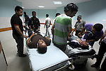 Palestinians wheel a wounded man at a hospital in Gaza City, following an Israeli air strike June 23, 2012. Israeli air strikes on Hamas security targets in Gaza killed two Palestinians and wounded 30 people on Saturday, medical  officials in the Islamist-ruled territory said, while heavier rocket fire by militants wounded an Israeli man. Photo by Ashraf Amra