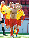 Albion's Gary Fisher celebrates after he scores the winning third goal.