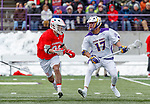 University at Albany Men's Lacrosse defeats Cornell 11-9 on Mar 4 at Casey Stadium.  Jakob Patterson (#17) looks for an opening.