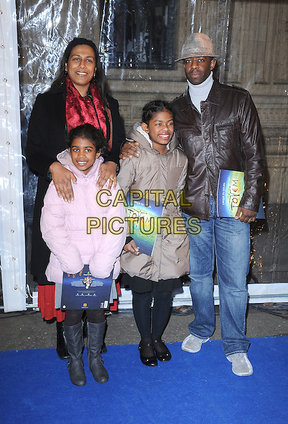 Adrian Lester & family.'Cirque Du Soleil: Totem' UK Premiere, Royal Albert Hall, London, England..5th January 2012.full length black pink brown jacket coat kids children red .CAP/BEL.©Tom Belcher/Capital Pictures..