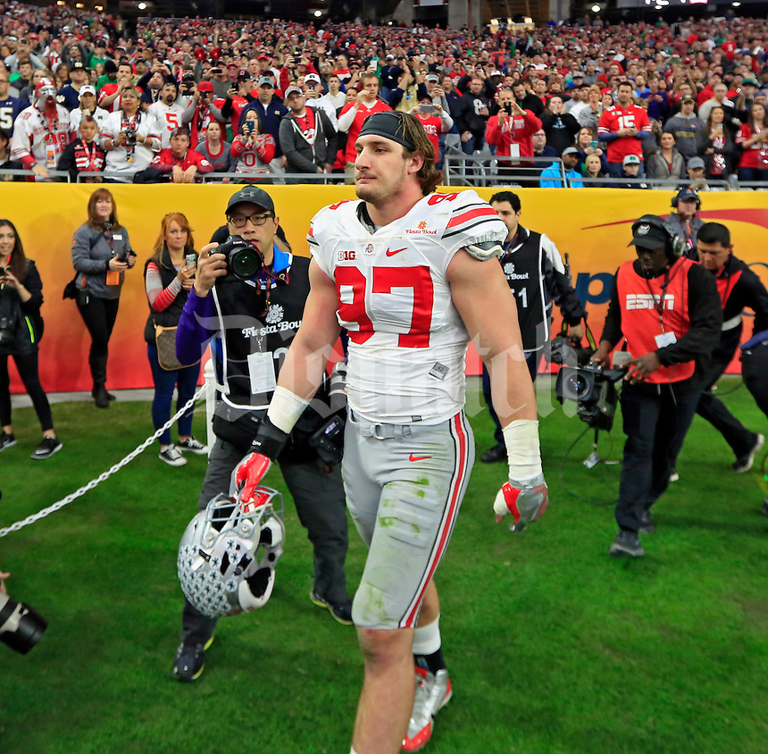 Ohio State Buckeyes defensive lineman Joey Bosa (97) gets injected after a hit on Notre Dame Fighting Irish quarterback DeShone Kizer (14) in the first quarter during the Fiesta Bowl in the University of Phoenix Stadium on January 1, 2016.  (Dispatch photo by Kyle Robertson)