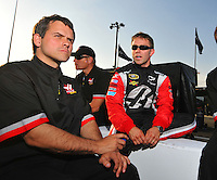 May 2, 2008; Richmond, VA, USA; NASCAR Sprint Cup Series driver Scott Riggs (right) talks with crew chief Bootie Barker during qualifying for the Dan Lowry 400 at the Richmond International Raceway. Mandatory Credit: Mark J. Rebilas-US PRESSWIRE