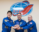 Expedition 54 prime crew members flight engineer Norishige Kanai of Japan Aerospace Exploration Agency (JAXA), right, Soyuz Commander Anton Shkaplerov of Roscosmos, center, and flight engineer Scott Tingle of NASA, right, pose for a picture at the conclusion of a press conference, Saturday, December 16, 2017 at the Cosmonaut Hotel in Baikonur, Kazakhstan. Expedition 54 Soyuz Commander Anton Shkaplerov of Roscosmos, flight engineer Scott Tingle of NASA, and flight engineer Norishige Kanai of Japan Aerospace Exploration Agency (JAXA) are scheduled to launch to the International Space Station aboard the Soyuz spacecraft from the Baikonur Cosmodrome on December 17.  <br /> Mandatory Credit: Joel Kowsky / NASA via CNP
