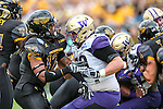 Southern Miss Golden Eagles linebacker D'Nerius Antoine (12) and Washington Huskies offensive lineman Coleman Shelton (79) in action during the Zaxby's Heart of Dallas Bowl game between the Washington Huskies and the Southern Miss Golden Eagles at the Cotton Bowl Stadium in Dallas, Texas.