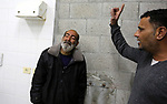 Relatives of Nedal Shatat, 29, who was killed by Israeli troop in clashes at Gaza-Israel border, mourn at the morgue of Al-Aqsa hospital in central Gaza strip, March 22, 2019. Three Palestinians were killed by Israeli fire on March 22 during clashes along the Gaza-Israel border, the health ministry in Hamas-run enclave said. Photo by Ashraf Amra