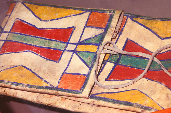 Colorful Blackfeet painted designs decorate a parfleche tepee storage bag