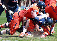 Virginia safety Anthony Harris (8) is tackled by Virginia guard Ross Burbank (65) and Virginia linebacker Micah Kiser (53) during the annual Virginia football Orange-Blue Spring Game Saturday at Scott Stadium in Charlottesville, VA. Photo/The Daily Progress/Andrew Shurtleff