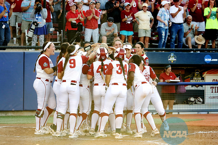 06 JUNE 2016: University of Oklahoma teammates celebrate at home play after Sydney Romero (2) hit a home run during the Division I Women's Softball Championship held at ASA Hall of Fame Stadium in Oklahoma City, OK.  University of Oklahoma defeated Auburn University in Game 1 by the final score of 3-2. Shane Bevel/NCAA Photos