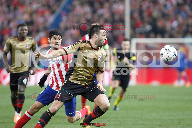 Atletico de Madrid´s Diego Costa (L) and Milan´s Adil Rami during 16th Champions League soccer match at Vicente Calderon stadium in Madrid, Spain. March 11, 2014. (ALTERPHOTOS/Victor Blanco)