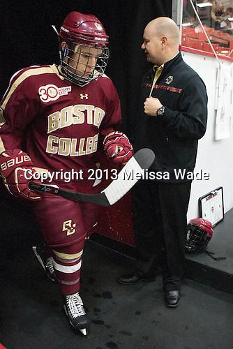Danny Linell (BC - 10), John Hegarty (BC - Dir-Hockey Ops) - The visiting Boston College Eagles defeated the Harvard University Crimson 5-1 on Wednesday, November 20, 2013, at Bright-Landry Hockey Center in Cambridge, Massachusetts.