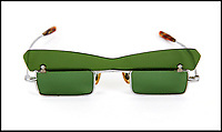 BNPS.co.uk (01202 558833)<br /> Pic:  JuliensAuctions/BNPS<br /> <br /> John Lennon's distinctive green sunglasses from the 'Penny Lane' video have emerged for sale for &pound;15,000.<br /> <br /> The Beatles star wore the narrow rectangular metal frame sunglasses, which also have a green-tinted flap, in the 1967 video.<br /> <br /> At the beginning of the video, Lennon is handed the sunglasses by Paul McCartney and then puts them on, with the camera doing a close-up of his eye-wear.<br /> <br /> They are being sold by former Emmerdale star Frazer Hines, whose musician brother Ian toured and recorded with the Fab Four in the 1960s.