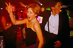 Cirencester, Gloucestershire. 1995 <br /> Sloane Ranger gives it all she's got on the disco dance floor at the Royal Agricultural College annual end of year dance.