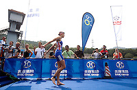 11 SEP 2011 - BEIJING, CHN - Helen Jenkins (GBR) walks onto the pontoon for the start of the 2011 Elite Womens ITU World Championship Series Grand Final Triathlon. Jenkins took second place but gained enough points to win the series .(PHOTO (C) NIGEL FARROW)