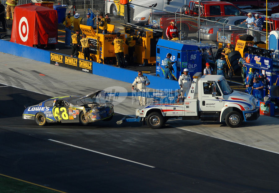 Oct 8, 2006; Talladega, AL, USA; The crashed car of Nascar Nextel Cup driver Jimmie Johnson (48) is towed back to the garage after a last lap crash during the UAW Ford 500 at Talladega Superspeedway. Mandatory Credit: Mark J. Rebilas