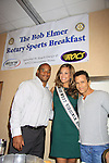 "Andrea Rogers (Miss West Virginia USA) poses with General Hospital's Scott Reeves ""Dr. Steven Lars Webber"" who is the Celebrity Grand Marshal and Sports Celebrity Virginia Tech, NFL, WFL wide receiver Shawn Scales at the 33rd Annual Mountain State Apple Harvest Festival (MSAHF) 2012 on October 20, 2012 at the Bob Elmer Celebrity Sports Breakfast sponsored by the Rotary Club in Martinsburg, West Virginia. (Photo by Sue Coflin/Max Photos)"