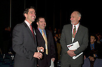March 20 2003, Montreal, Quebec, Canada<br /> <br /> David Anderson, Canada's Environment Minister (R) and Andre Boisclair , Quebec's Environment Minister (L)joke with Martin Dussaault, President of Reseau Environnemet at  the Opening plenary Session of Americana, a 3 days <br /> conference &amp; trade show on environement and waste management organized by Reseau Environnement, March 20 2003 in Montreal, Canada.<br /> <br /> Mandatory Credit: Photo by Pierre Roussel- Images Distribution. (&copy;) Copyright 2003 by Pierre Roussel <br /> <br /> NOTE : <br />  Nikon D-1 jpeg opened with Qimage icc profile, saved in Adobe 1998 RGB<br /> .Uncompressed  Original  size  file availble on request.
