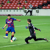 8th July 2020; Camp Nou, Barcelona, Catalonia, Spain; La Liga Football, Barcelona versus Espanyol;  Barca's Luis Suarez shoots and scores past keeper López during a Spanish league football match between RCD Espanyol and Barcelona in Barcelona
