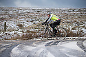 11/12/14<br /> <br /> A cyclist braves the cold to make his way along the A53 between Buxton and Leek after overnight snow fall settles on hills in the Derbyshire Peak District.<br /> <br /> ***ANY UK EDITORIAL PRINT USE WILL ATTRACT A MINIMUM FEE OF £130. THIS IS STRICTLY A MINIMUM. USUAL SPACE-RATES WILL APPLY TO IMAGES THAT WOULD NORMALLY ATTRACT A HIGHER FEE . PRICE FOR WEB USE WILL BE NEGOTIATED SEPARATELY***<br /> <br /> <br /> All Rights Reserved - F Stop Press. www.fstoppress.com. Tel: +44 (0)1335 300098