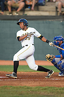 Julio De La Cruz (29) of the Bristol Pirates follows through on his swing against the Burlington Royals at Boyce Cox Field on July 10, 2015 in Bristol, Virginia.  The Pirates defeated the Royals 9-4. (Brian Westerholt/Four Seam Images)
