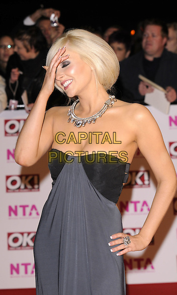 GEMMA MERNA .arriving at the National Television Awards held at the Royal Albert Hall,  London, England, 29th October 2008..red carpet arrivals half length grey gray strapless necklace dress long maxi hands on hips touching head .CAP/FIN.©Steve Finn/Capital Pictures