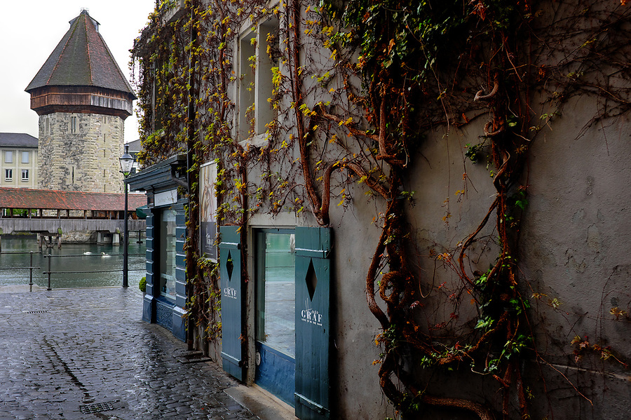 Wasserturm Tower and cobblestone street near Reuss River, Old Town Lucerne, Switzerland, Europe