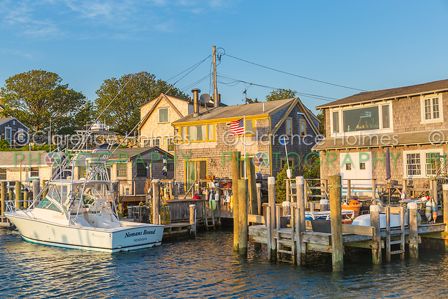 A view of boats docked in Menemsha Basin just before sunset, in the fishing village of Menemsha in Chilmark, Massachusetts on Martha's Vineyard.