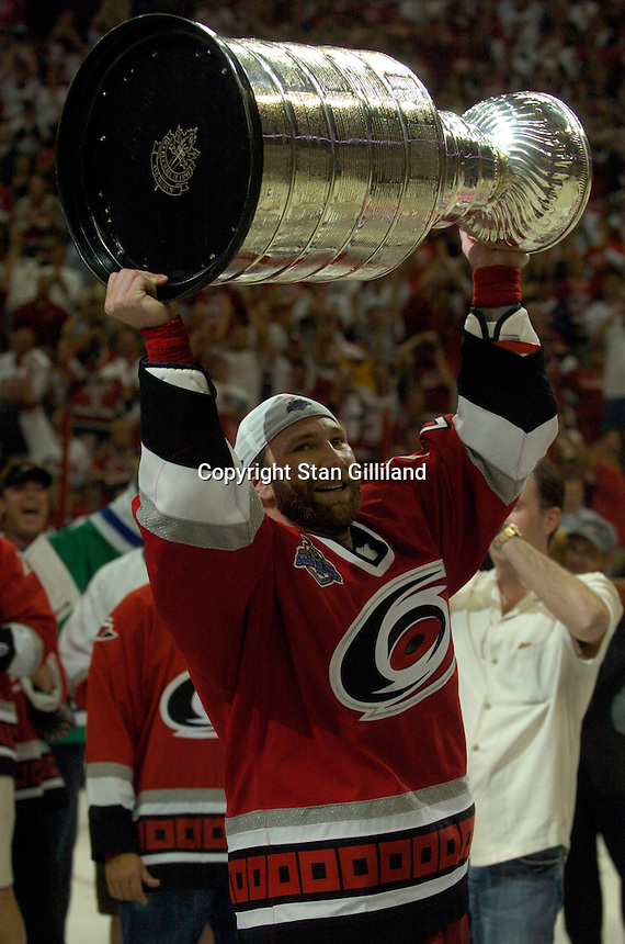 Erik Cole holds the Stanley Cup after the Carolina Hurricanes beat the Edmonton Oilers 3-1 in game seven to win the series at the RBC Center in Raleigh, NC Monday, June 19, 2006.