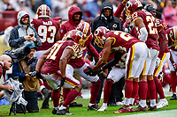 Landover, MD - September 23, 2018: Washington Redskins defensive backs celebrate Washington Redskins cornerback Fabian Moreau (31) strip fumble on the sideline during game between the Green Bay Packers and the Washington Redskins at FedEx Field in Landover, MD. The Redskins get the win 31-17 over the visiting Packers. (Photo by Phillip Peters/Media Images International)