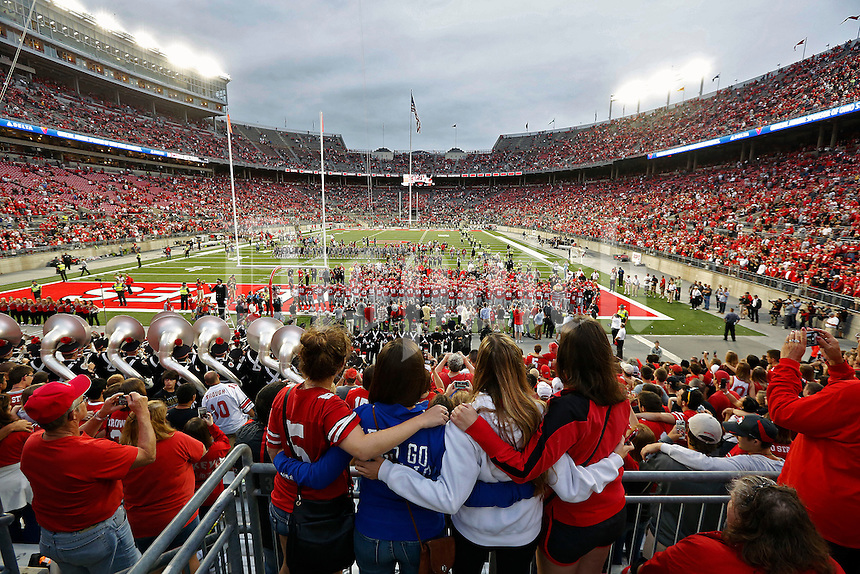 Ohio State Buckeyes fans sing Carmen Ohio after the Buckeyes beat Western Michigan Broncos 38-12 at Ohio Stadium on September 26, 2015.  (Dispatch photo by Kyle Robertson)
