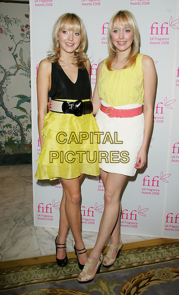 SAMANTHA & AMANDA MARCHANT .Attending the FIFI UK Fragrance Awards 2008 at the Dorchester Hotel, Park Lane, London, England, April 23rd 2008.full length samanda sam big brother twins sisters yellow fluro ruffle tiered skirt top black vest belt red white Topshop beige shoes double strap mary janes .CAP/ROS.©Steve Ross/Capital Pictures