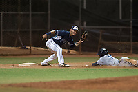 AZL Padres 2 shortstop Tucupita Marcano (1) prepares to apply the tag to Jawuan Harris (13) during an Arizona League game against the AZL Padres 1 at Peoria Sports Complex on July 14, 2018 in Peoria, Arizona. The AZL Padres 1 defeated the AZL Padres 2 4-0. (Zachary Lucy/Four Seam Images)