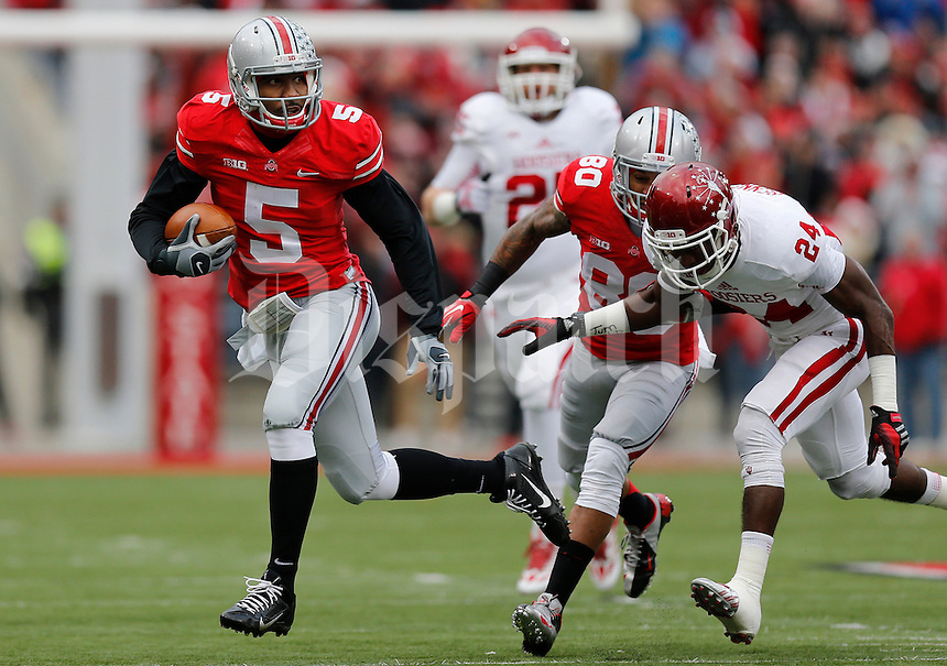 Ohio State Buckeyes quarterback Braxton Miller (5) breaks away from the Indiana Hoosiers defense as he keeps the ball in the first quarter of the college football game between the Ohio State Buckeyes and the Indiana Hoosiers at Ohio Stadium in Columbus, Saturday afternoon, November 23, 2013. As of half time the Ohio State Buckeyes led the Indiana Hoosiers 28 - 0. (The Columbus Dispatch / Eamon Queeney)