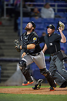 Akron RubberDucks catcher Eric Haase (13) makes a play on a foul ball as umpire Richard Riley looks on during a game against the Binghamton Rumble Ponies on May 12, 2017 at NYSEG Stadium in Binghamton, New York.  Akron defeated Binghamton 5-1.  (Mike Janes/Four Seam Images)