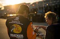 13-21 February, 2016, Daytona Beach, Florida USA<br /> Martin Truex Jr, Furniture Row Toyota Camry signs an autograph for a fan.<br /> ©2016, F. Peirce Williams