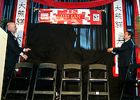 Zoo Atlanta president Dennis Kelly (left) and Chengdu Research Base of Giant Panda Breeding director Dr. Zhang Zhihe unveil the name of the zoo's giant panda cub during a ceremony. ?Mei Lan,? which translates to ?Atlanta Beauty? won in an online poll, receiving 22% of the 57,015 votes cast. Voters were given a list of 10 names from which to choose. The names were suggested by several institutions interested in panda conservation including local media, Zoo Atlanta staff and volunteers, Panda Express (a Zoo Atlanta sponsor) and the people of China.<br />
