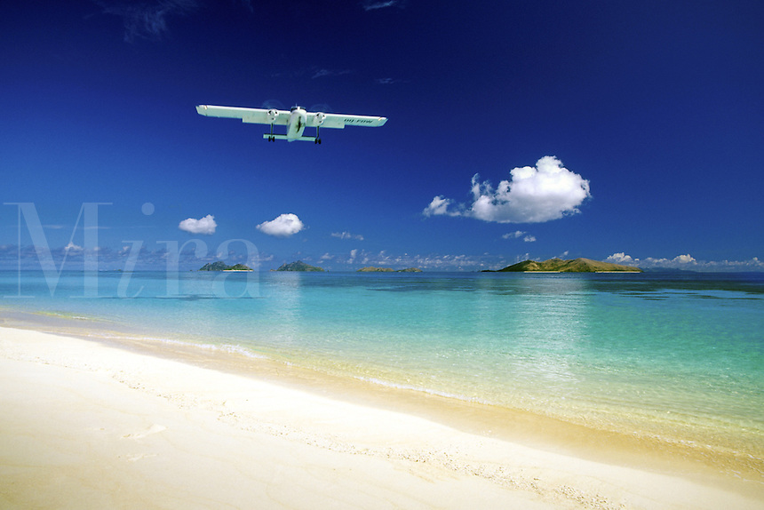 Tropical island scene on Mana Island in the Mamanucas Group, Fiji. Small planes are the common mode of transportation around this island nation.