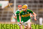 Brendan O'Leary Kerry races away from Barry Nash Limerick during their Munster cup clash  in the Gaelic Grounds on Sunday