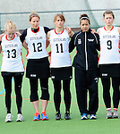 FRANKFURT AM MAIN, GERMANY - April 14: Katharina Schroer #13 of Germany, Eva Schulte #12 of Germany, Julia Duerr #11 of Germany, Nora Schroeder #10 of Germany and Kristina Schaefer #9 of Germany during the national anthem before the Deutschland Lacrosse International Tournament match between Germany vs Great Britain during the on April 14, 2013 in Frankfurt am Main, Germany. Great Britain won, 10-9. (Photo by Dirk Markgraf)