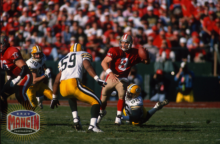 SAN FRANCISCO, CA:  Quarterback Steve Young of the San Francisco 49ers throws a pass during the NFC playoff game against the Green Bay Packers at Candlestick Park in San Francisco, California on January 6, 1996. (Photo by Brad Mangin)