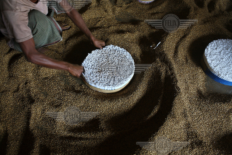 Production at a hand rolled cigarette (locally called a bidi) factory in Haragach. Workers have to labour from dawn to dusk making bidis filled with tobacco flakes, earning very little money and in hazardous conditions which can damage their health.
