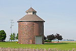 Round masonry corn crib (barn), corn stubble in field, Grundy Co., Ill.