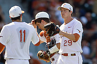 Texas Longhorns pitcher Corey Knebel #29 is greeted by teammate Alex Silver #11 after recording the final out of the eighth inning against the Oklahoma Sooners in the NCAA baseball game on April 6, 2013 at UFCU DischFalk Field in Austin, Texas. The Longhorns defeated the rival Sooners 1-0. (Andrew Woolley/Four Seam Images).