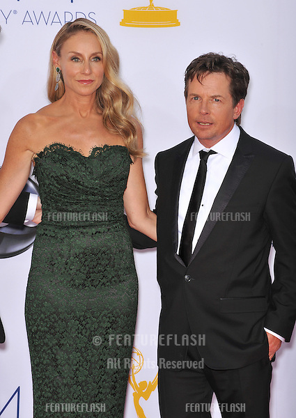 Michael J. Fox & wife Tracy Pollan at the 64th Primetime Emmy Awards at the Nokia Theatre LA Live..September 23, 2012  Los Angeles, CA.Picture: Paul Smith / Featureflash
