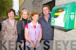 Susan English, Mary O'Connor, Mary Coleman Horgan and Eugene O'Neill, Beaufort Defibrillator Group, pictured with one of the five heated defibrillator boxes in the Beaufort Community.