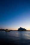 Sunrise at Sydney's famous Harbour, taken from a water taxi at dawn, of the World Famous Opera House and Harbor Bridge.