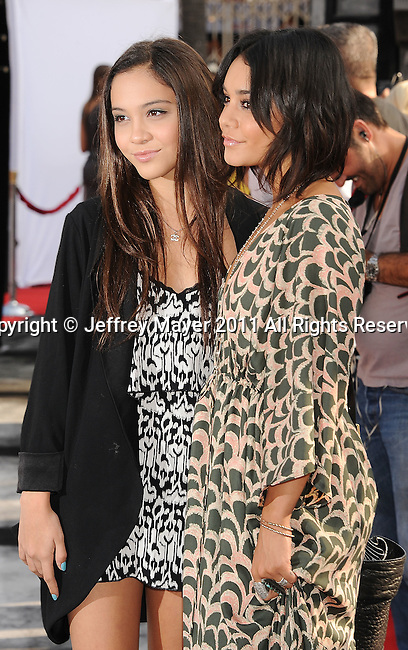 "HOLLYWOOD, CA - SEPTEMBER 25: Stella Hudgens and Vanessa Hudgens attend Premiere Of ""Iris"" - A Journey Into The World Of Cinema By Cirque du Soleil at the Kodak Theatre on September 25, 2011 in Hollywood, California."