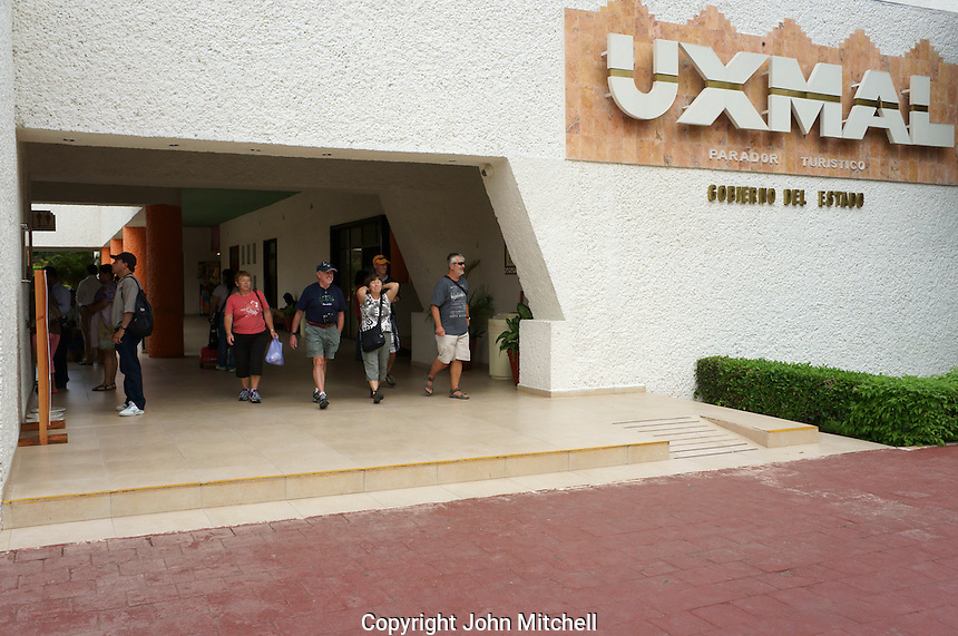 Group of tourists leaving the visitors center at Mayan ruins of Uxmal, Yucatan, Mexico.